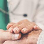 doctor holding patient hands