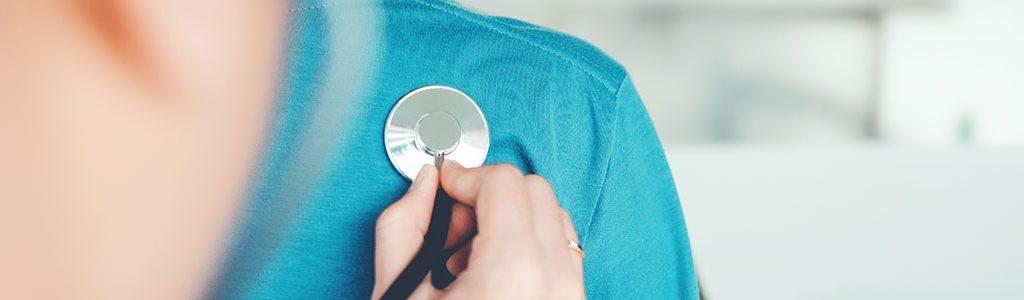 stethoscope on patient's shoulder