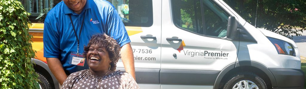 Virginia Premier employee pushing woman in wheelchair
