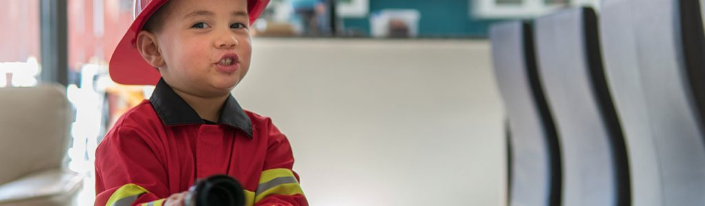 boy dressed up as a fireman