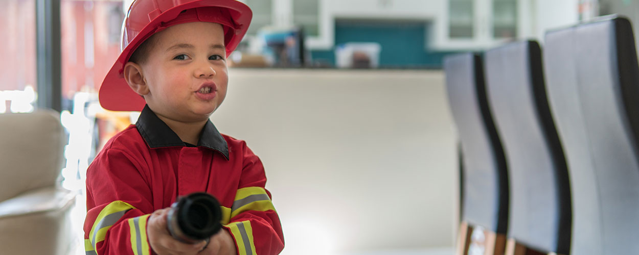 boy dressed up as a fireman