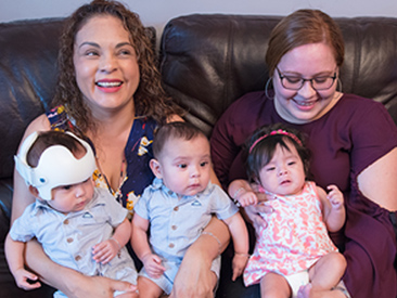 mom holding triplet babies