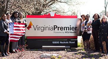 virginia Premier employees in front of virginia premier sign